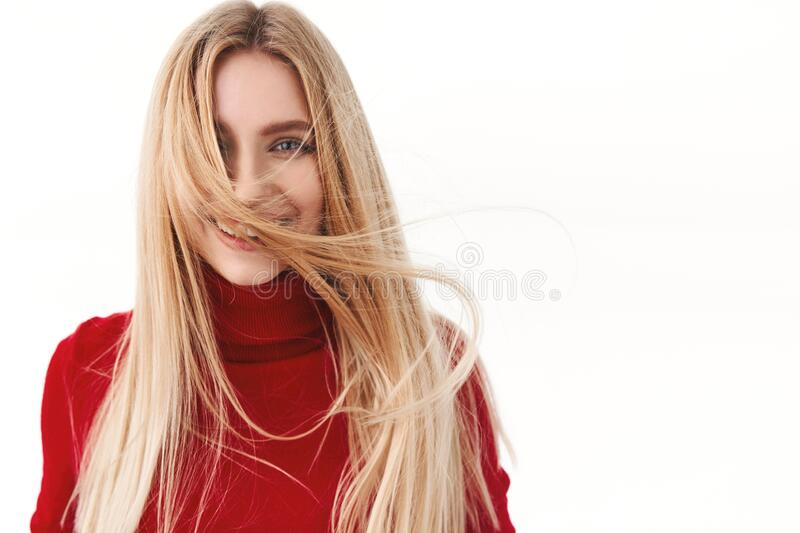 Beauty, women and fashion concept. Portrait of attractive young woman with beautiful long hair floating in air, smiling royalty free stock photos