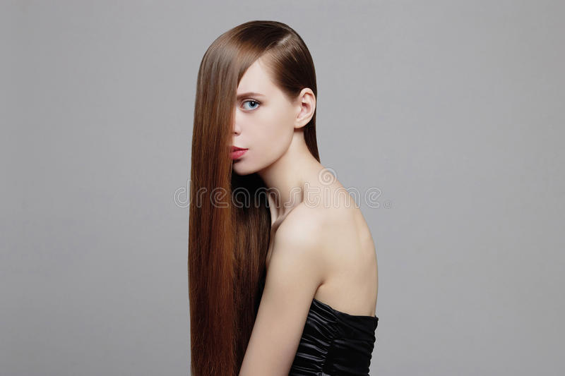 Beauty Woman with Healthy Brown Hair royalty free stock photos