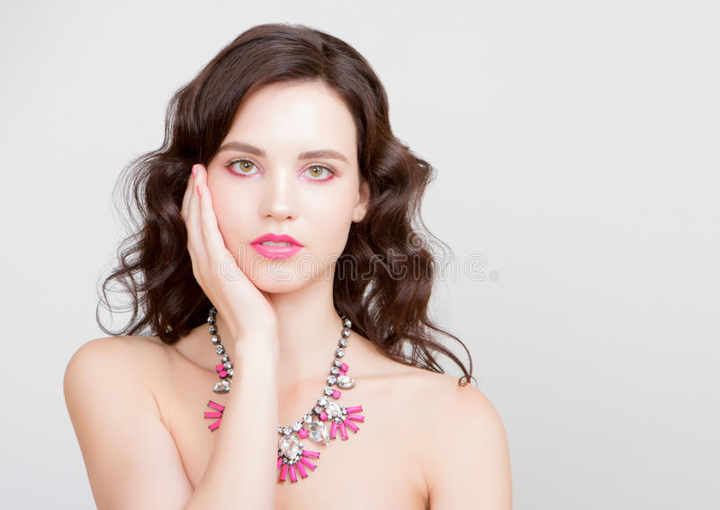 Beauty woman with jewelry perfect skin portrait beautiful brunette spa girl showing empty copy royalty free stock photography