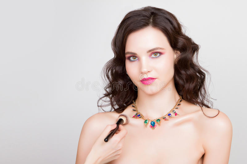 Beauty woman with jewelry perfect skin portrait beautiful brunette spa girl showing empty copy royalty free stock images