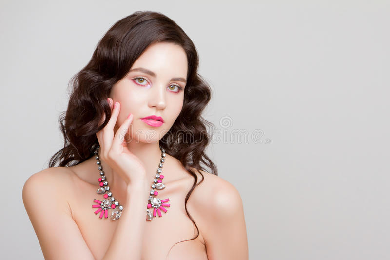 Beauty woman with jewelry perfect skin portrait beautiful brunette spa girl showing empty copy stock photography