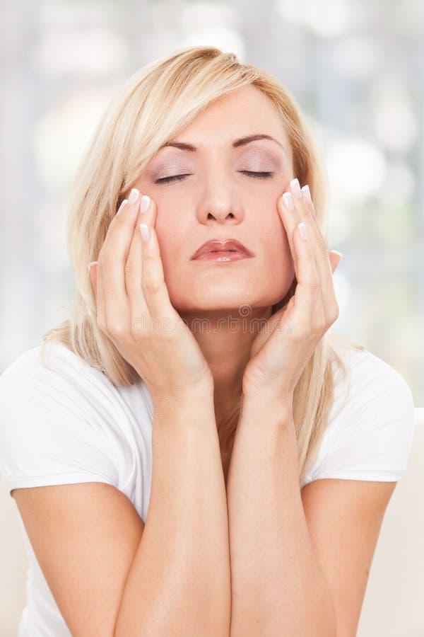 Beauty Woman Massaging Her Face Stock Photo