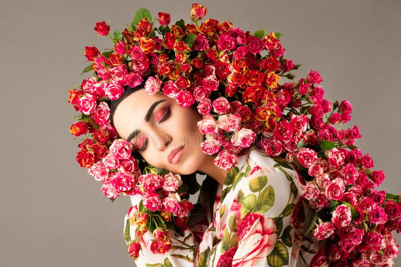 Beauty woman model with red roses flower wreath and fashion makeup face stock photography