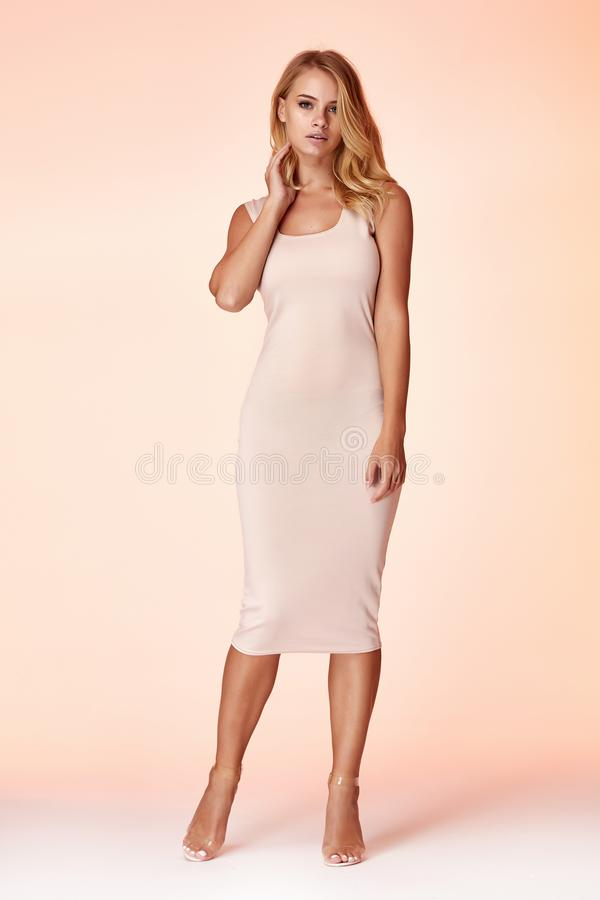 Beauty woman model wear stylish design trend clothing natural organic wool cotton dress casual formal office style for work. Meeting walk party blond hair stock photos