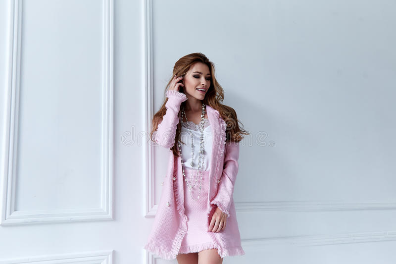 Beauty woman model wear stylish design trend clothing silk pink. Jacket suit skirt casual formal office style walk party long blond hair makeup party stock photos