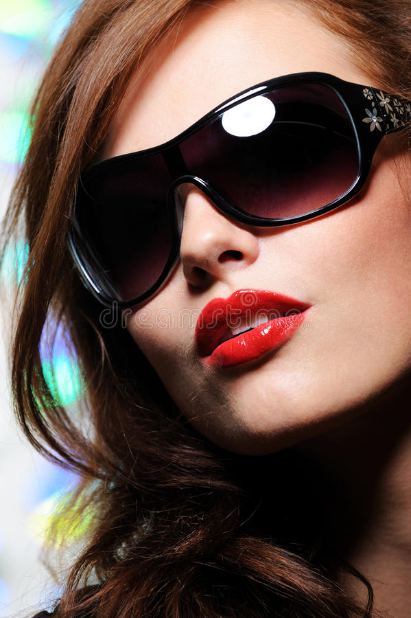Beauty woman in modern sunglasses royalty free stock photography