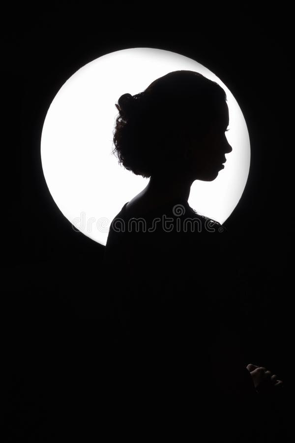 Woman monochrome silhouette over circle royalty free stock photo