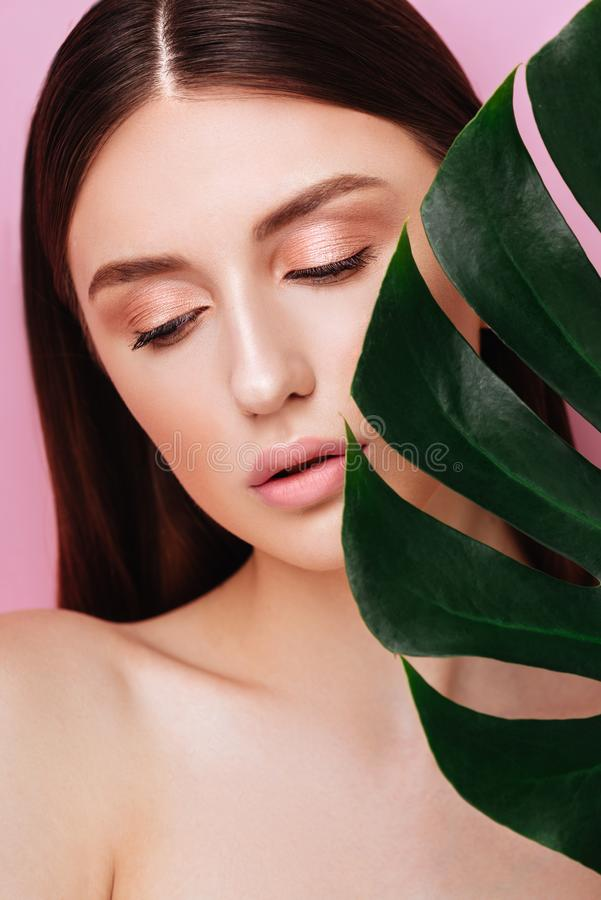 Beauty Woman with natural green palm leaf Portrait stock images