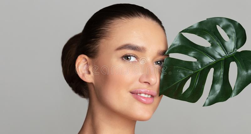 Beauty woman with natural green palm leaf royalty free stock photo