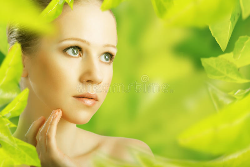 Beauty woman and a natural skin care in green stock photos