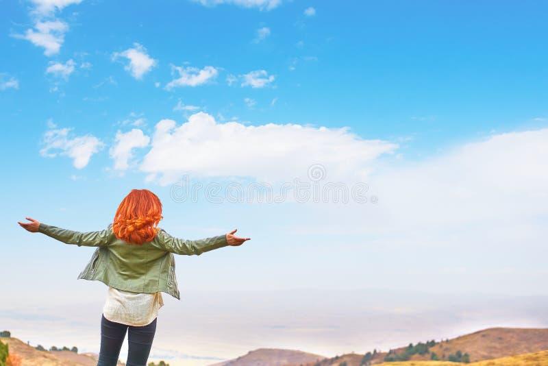 Beauty woman outdoors enjoying nature. royalty free stock image
