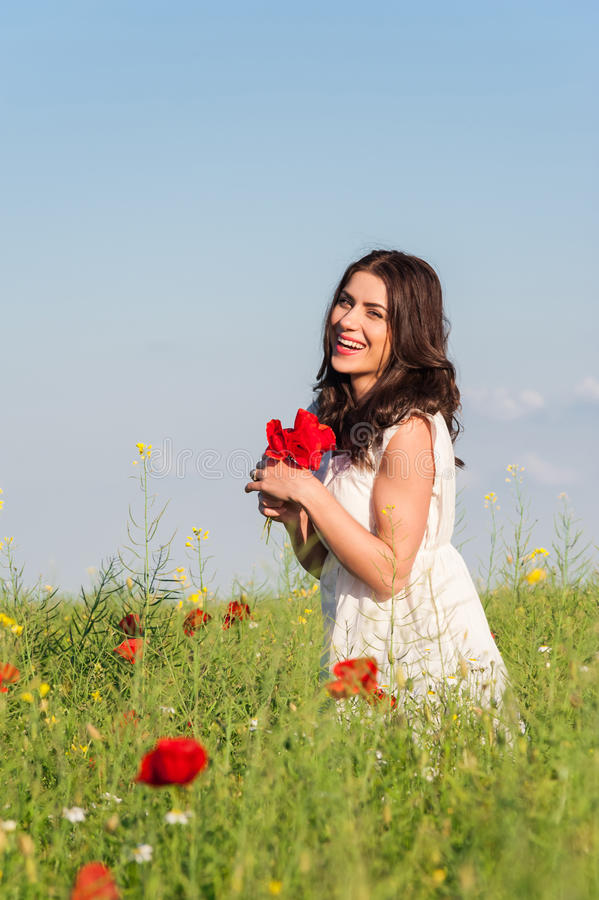 Download Beauty Woman In Poppy Field In White Dress Holding A Poppies Bouquet Stock Image - Image: 40924513