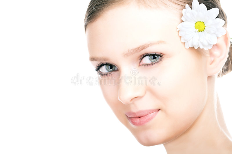 Beauty woman portrait with camomile flower. On white background stock photography