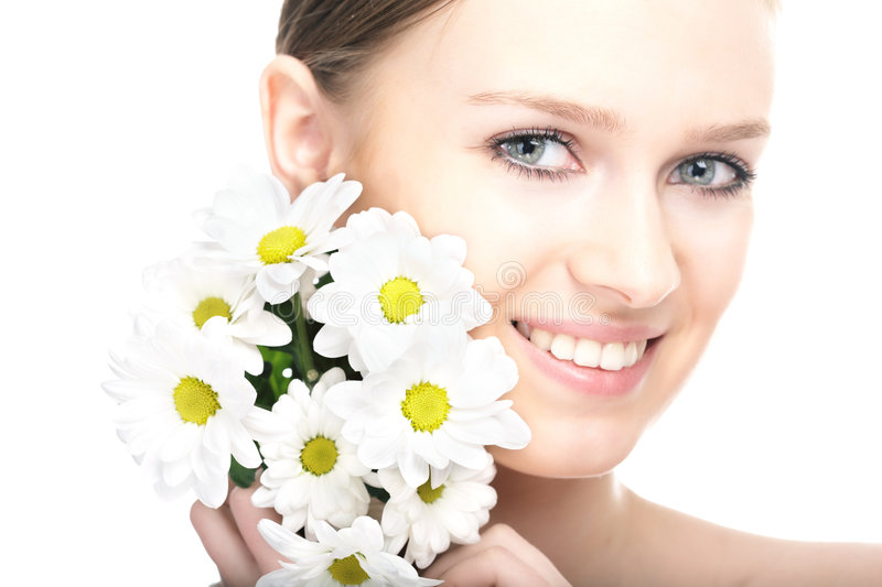 Beauty woman portrait with camomile flower. On white background royalty free stock photo