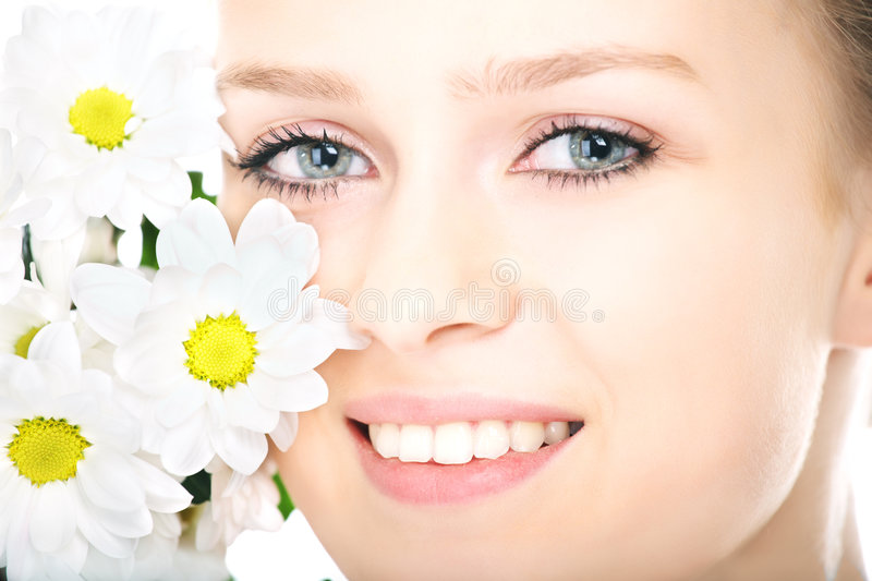 Beauty woman portrait with camomile flower. On white background royalty free stock photography
