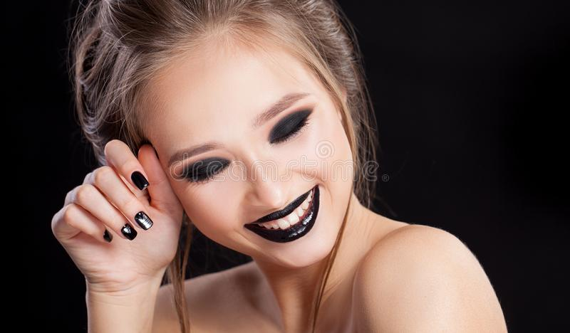 Beauty Woman Portrait. Professional Makeup and Manicure with smokey eyes. Black colors. Copy-space. Studio royalty free stock photography