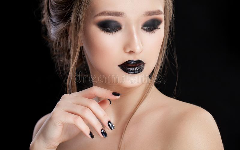 Beauty Woman Portrait. Professional Makeup and Manicure with smokey eyes. Black colors. Copy-space. Studio stock photos