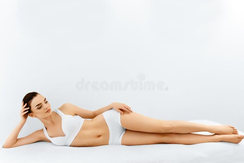 Beauty Woman Portrait. Spa Face, Clean Skin. Body Care Concept. Beauty Woman. Portrait Of Beautiful Smiling Spa Model Woman Touching Her Face Lying In Spa Salon stock image