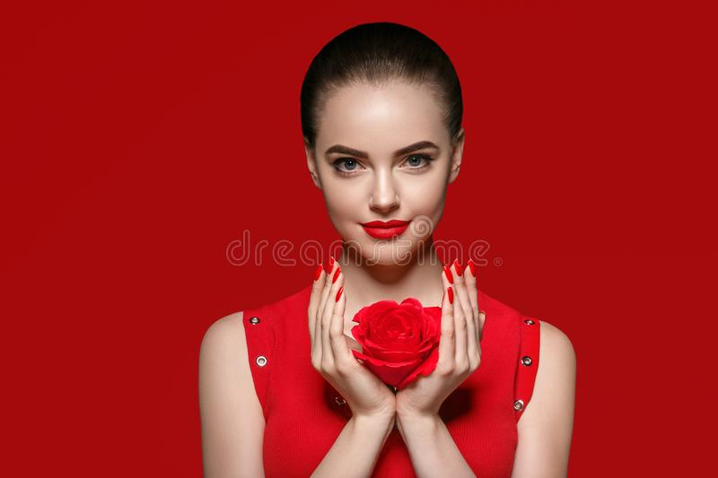 Beauty woman with rose flower beautiful curly hair and lips. Studio shot royalty free stock photos