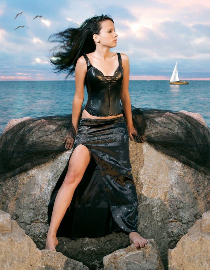 Beauty woman on sea royalty free stock photography