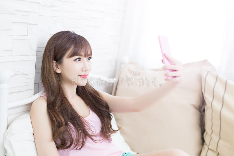 Beauty woman selfie. Beauty woman feel relax and selfie on the bed royalty free stock image
