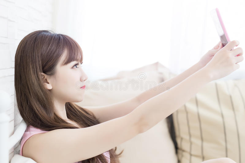 Beauty woman selfie. Beauty woman feel relax and selfie on the bed stock photos