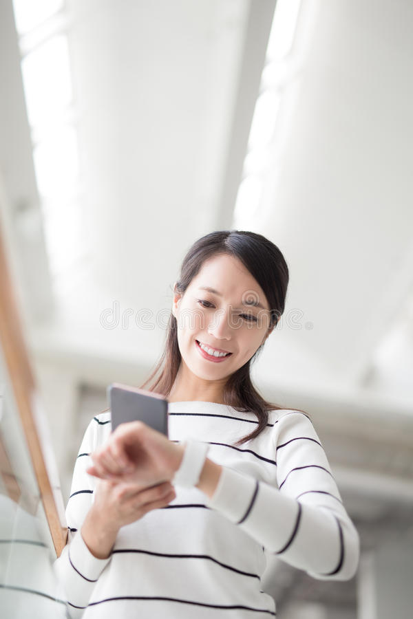 Beauty woman take smartphone stock image