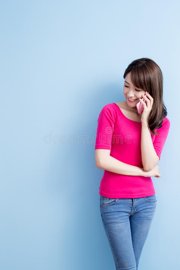 Beauty woman talk on phone. On blue background stock images