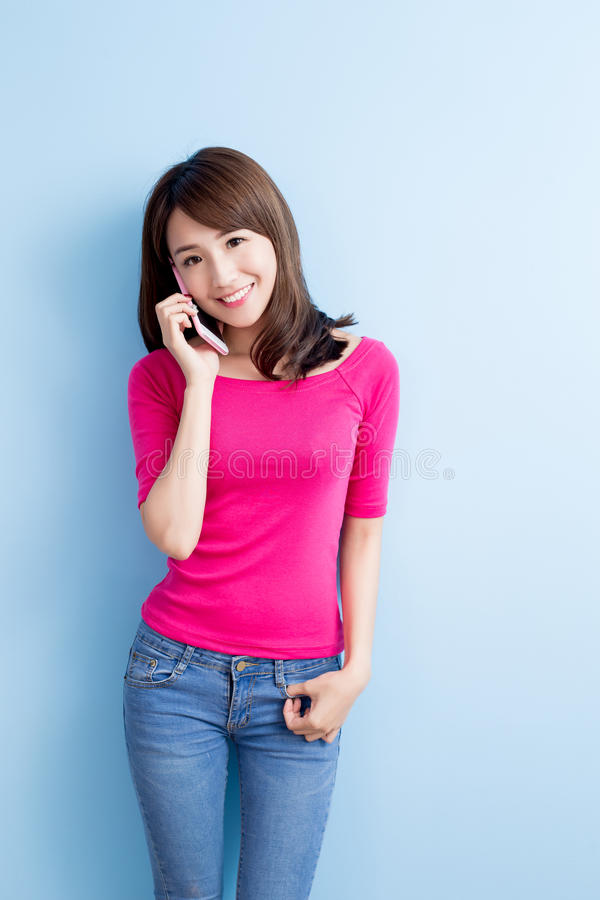 Beauty woman talk on phone. On blue background stock image