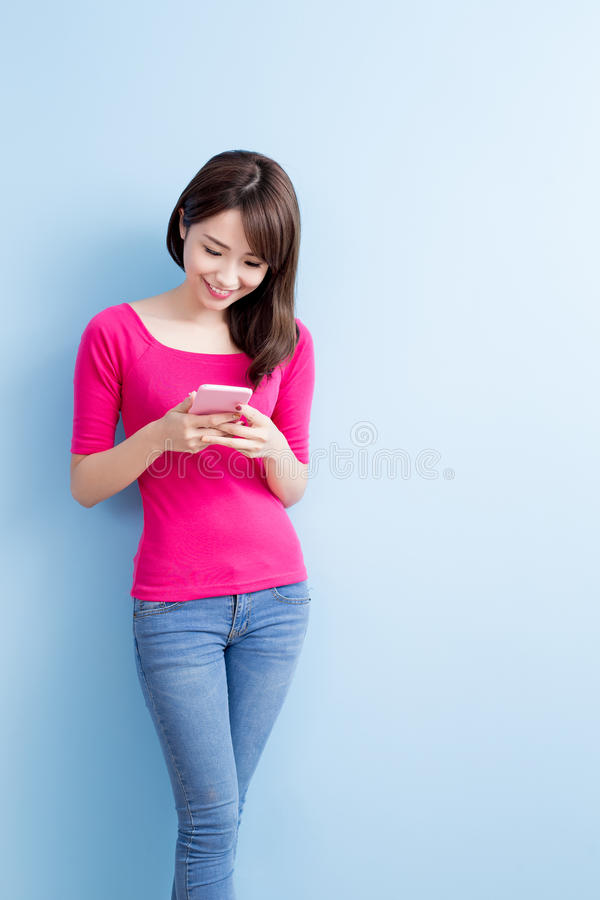 Beauty woman talk on phone. On blue background royalty free stock photography