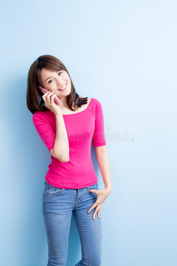Beauty woman talk on phone. On blue background royalty free stock images