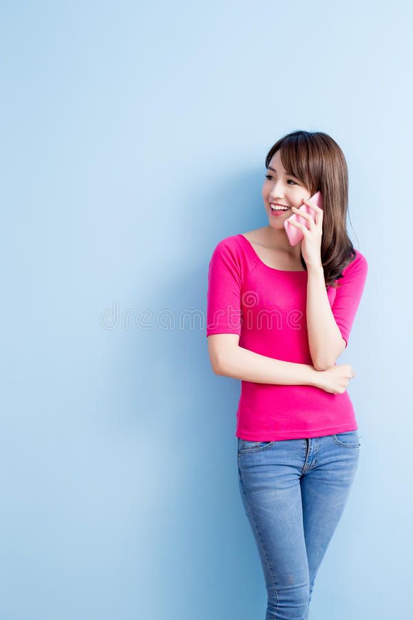 Beauty woman talk on phone. On blue background royalty free stock image