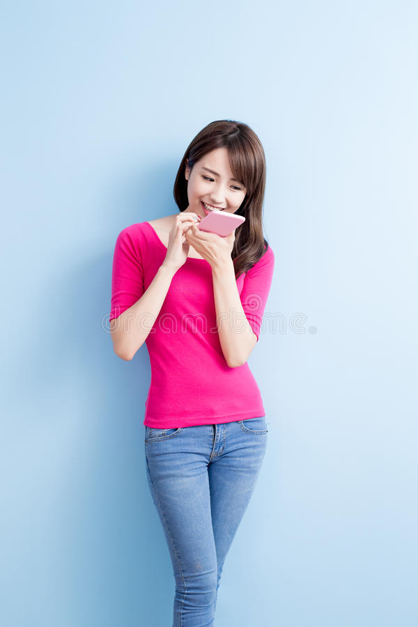 Beauty woman talk on phone. On blue background royalty free stock photos