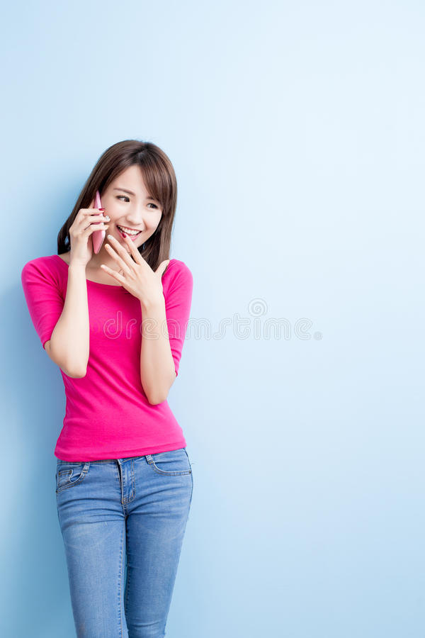 Beauty woman talk on phone. Isolated on blue background royalty free stock image