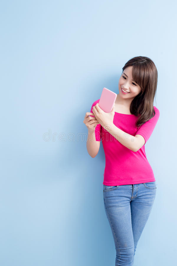Beauty woman talk on phone. Isolated on blue background royalty free stock images