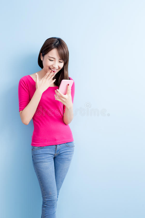 Beauty woman talk on phone. Isolated on blue background stock image