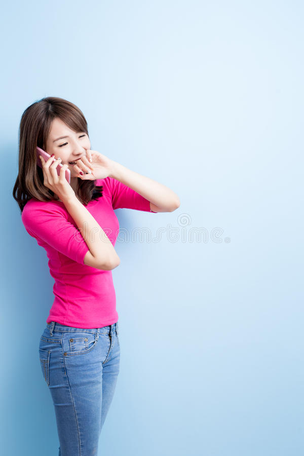 Beauty woman talk on phone. Isolated on blue background stock photos
