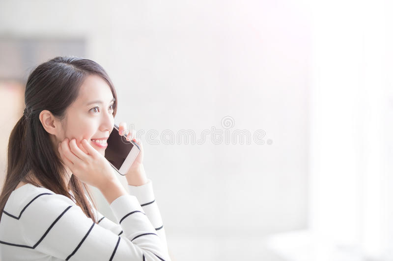 Beauty woman talk on phone. And look somewhere in hongkong stock photo