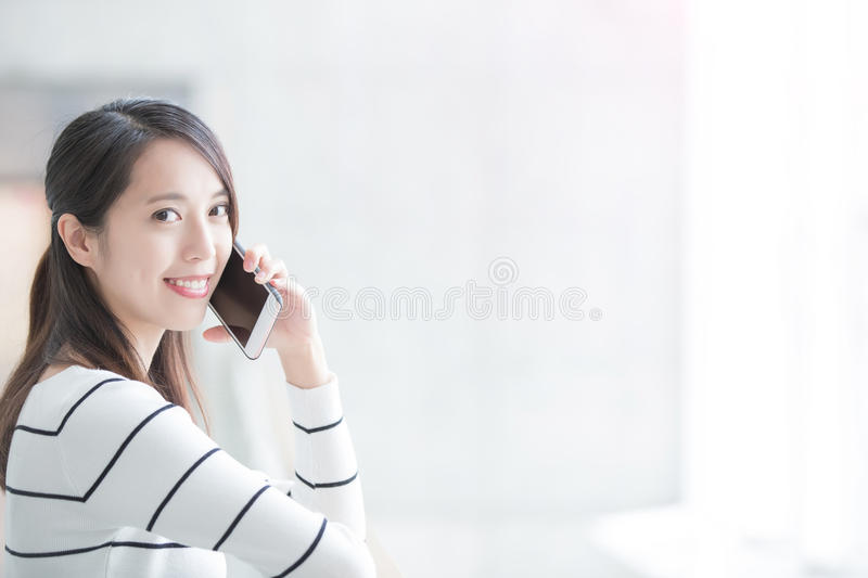 Beauty woman talk on phone. And look you in hongkong stock photography