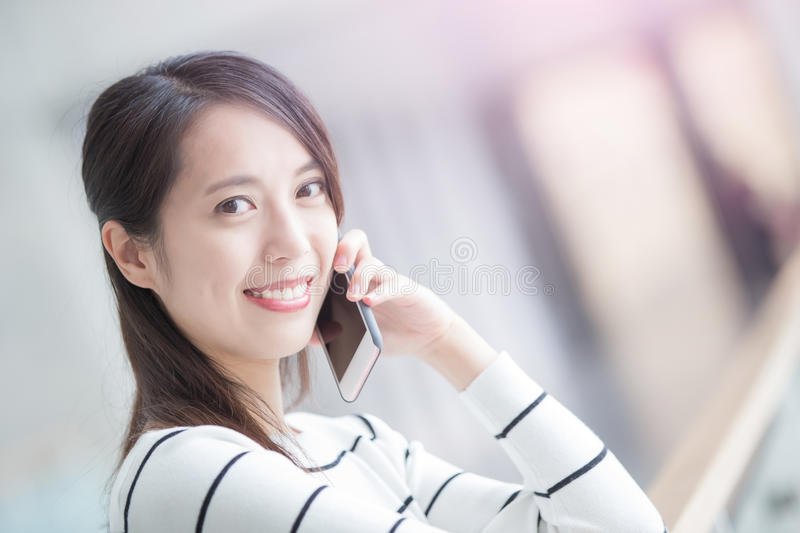 Beauty woman talk on phone. And look you in hongkong stock photo