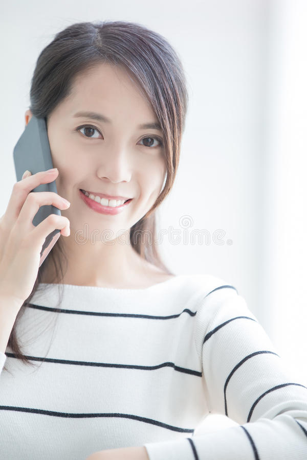 Beauty woman talk on phone. And look you in hongkong stock photos