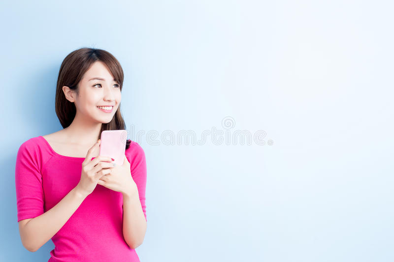 Beauty woman use cellphone. On blue background royalty free stock photo