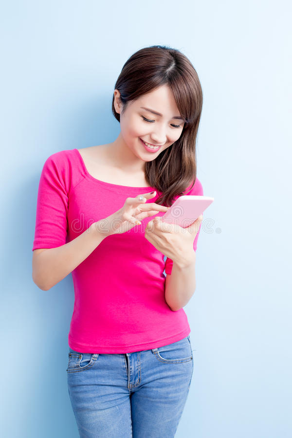 Beauty woman use cellphone. On blue background stock image