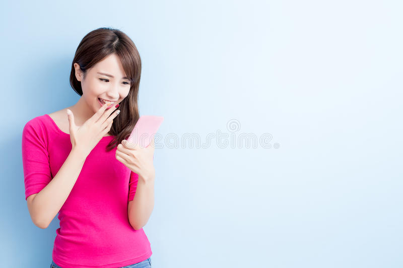 Beauty woman use cellphone. Isolated on blue background royalty free stock photos