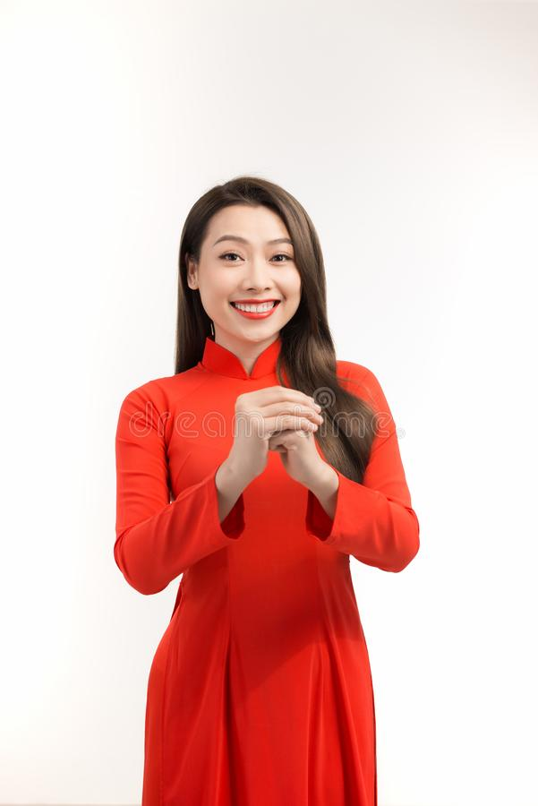 Beauty woman wear aodai and smile to you in chinese new year stock photos
