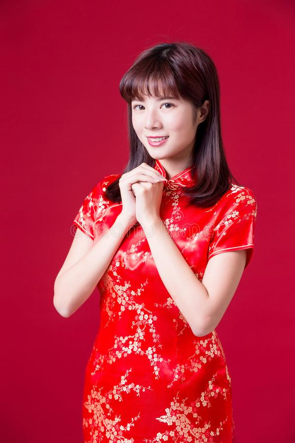 Woman with chinese new year. Beauty woman wear cheongsam and smile to you in chinese new year stock photography