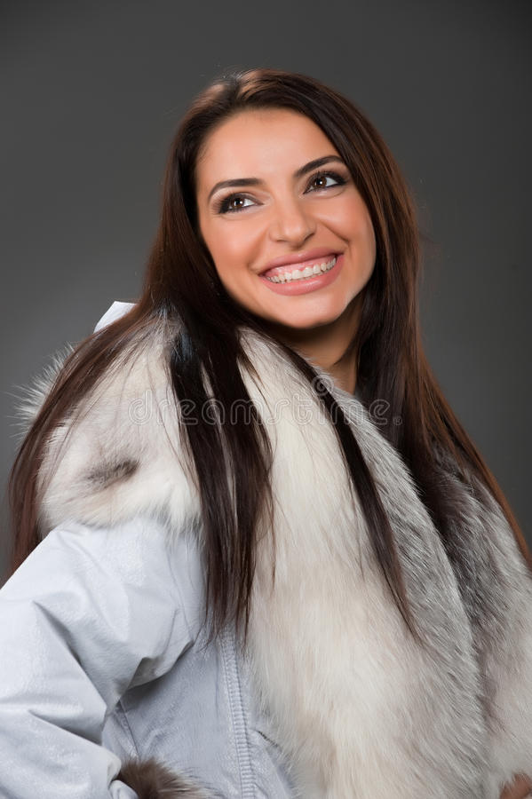 Beauty woman wearing fur stock images