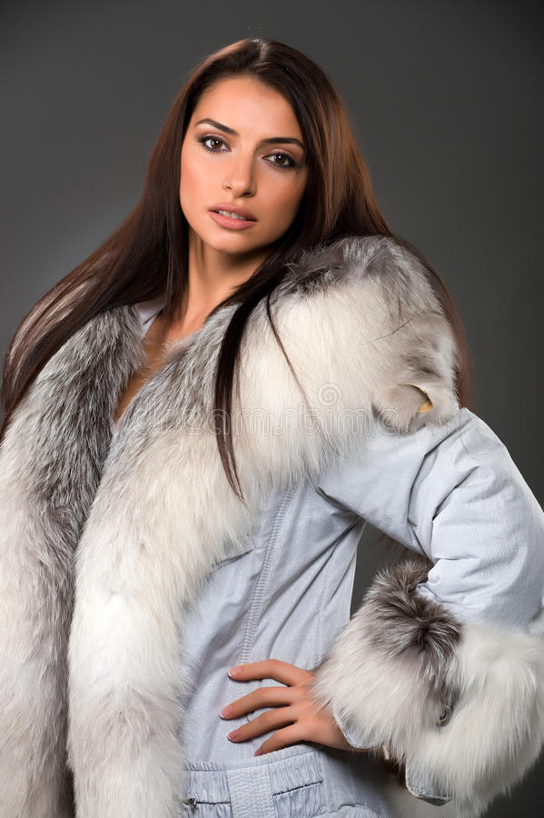 Beauty woman wearing fur royalty free stock photo