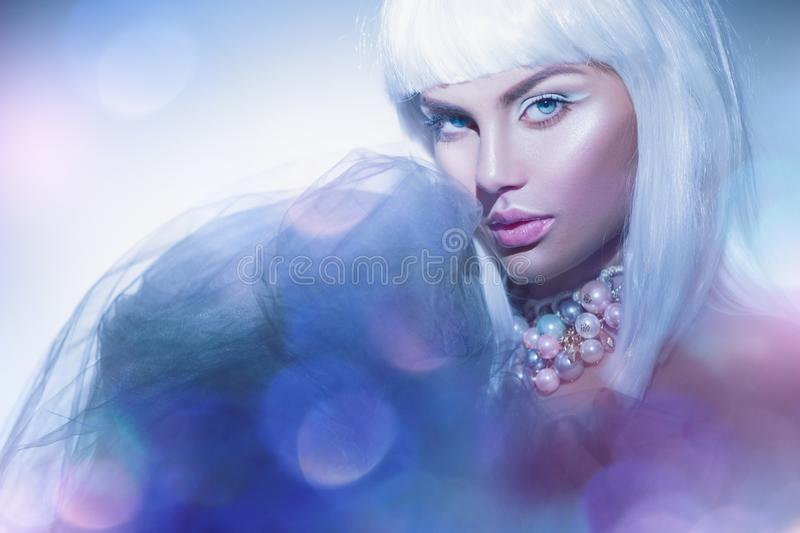 Beauty woman with white hair and winter style makeup. High fashion model girl portrait. Beautiful model with short blond hair royalty free stock images