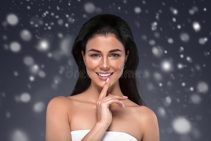 Beauty Woman Winter Snow face Portrait. Beautiful Spa model Girl stock photography